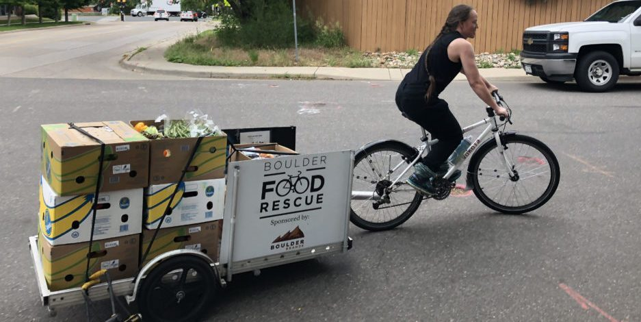 Volunteer, riding with food delivery